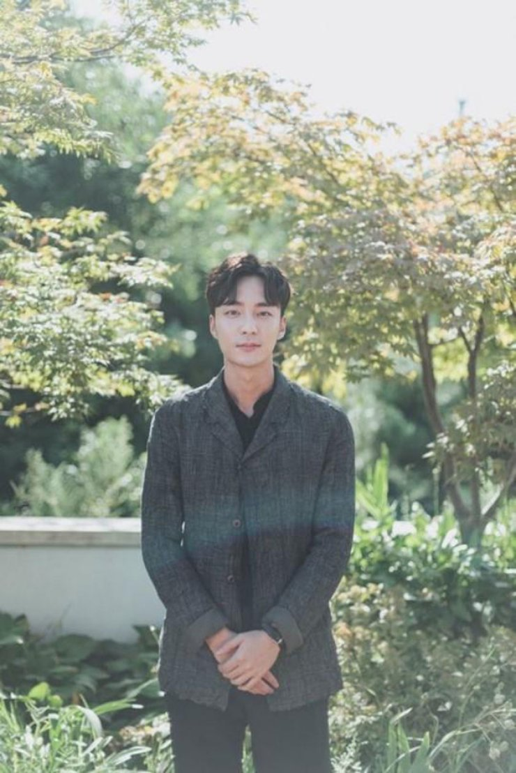 K-pop singer Roy Kim was booked for sharing sex photos in a chat room where another singer, Jung Joon-young, uploaded his own illicit videos, the Seoul Metropolitan Police Agency said, Thursday. / Courtesy of Stone Music Entertainment