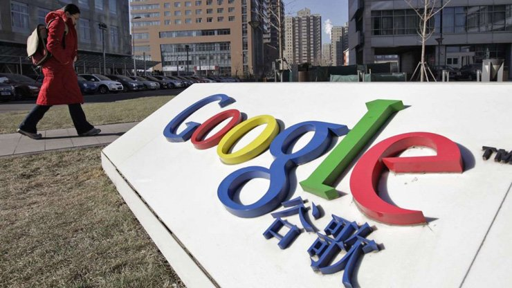 A woman walks past the logo of Google in front of its headquarters in Beijing in 2011. Google has been keen to return to China since it pulled out in 2010.