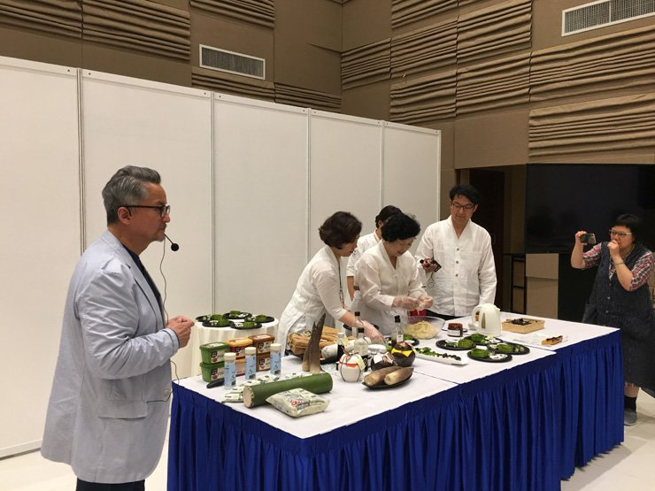 Chef Ki Soon-do, center, presents her family recipe for 'jang,' a traditional Korean fermented sauce, at a culture event in Singapore, Friday. To her left are Korean restaurant owner Vivian Han and East Asia Cultural Project Chairman Kim Sang-woo. / Courtesy of East Asia Cultural Project