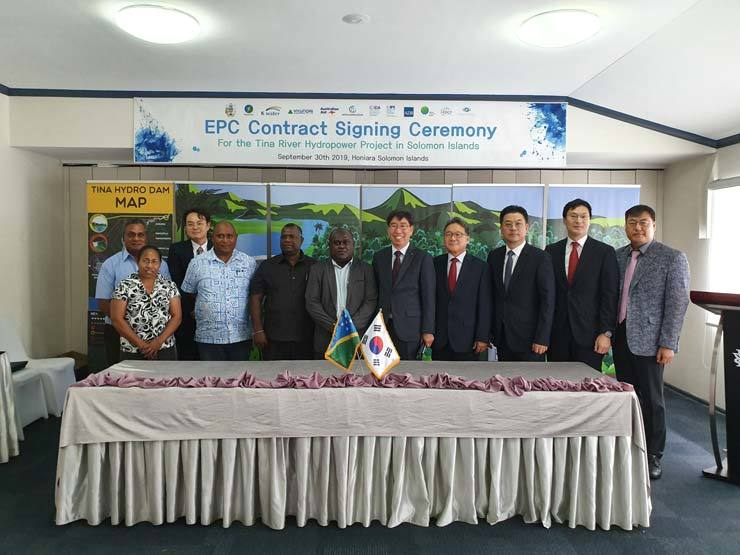 Hyundai Engineering CEO Kim Chang-hag, fourth from right, Chief International Officer of K-water Kim Duk-joong, fifth from right, and Minister of Finance and Treasury of the Solomon Islands Harry Kuma, sixth from right, pose for a picture after signing a contract for a hydroelectric power plant construction project on the Tina River, at the Heritage Park Hotel in Honiara, the Solomon Islands, Monday. /Courtesy of K-water