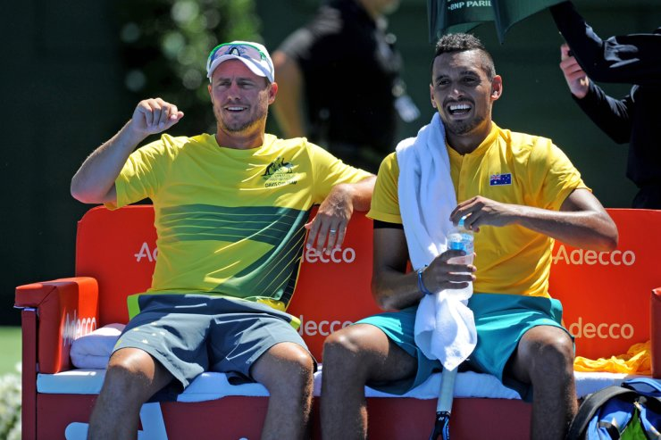 Australian tennis player Nick Kyrgios, right, smiles with team captain Lleyton Hewitt during the Australia-Czech Republic Davis Cup first round in Melbourne, Friday. Australia won the game 1-0. The Davis Cup is the premier international team competition in men's tennis. / EPA-Yonhap