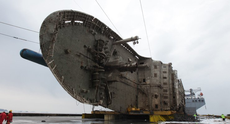 The rusted Sewol ferry lies on a giant submersible ship off Jindo Island on Sunday. / Yonhap