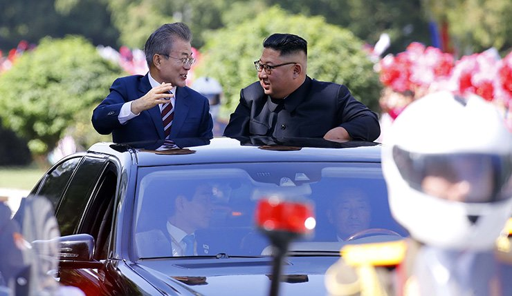 South Korean President Moon Jae-in, left, and North Korean leader Kim Jong-un talk while heading to Paekhwawon, a state guesthouse in Pyongyang, where Moon will stay during his visit. Joint Press Corps