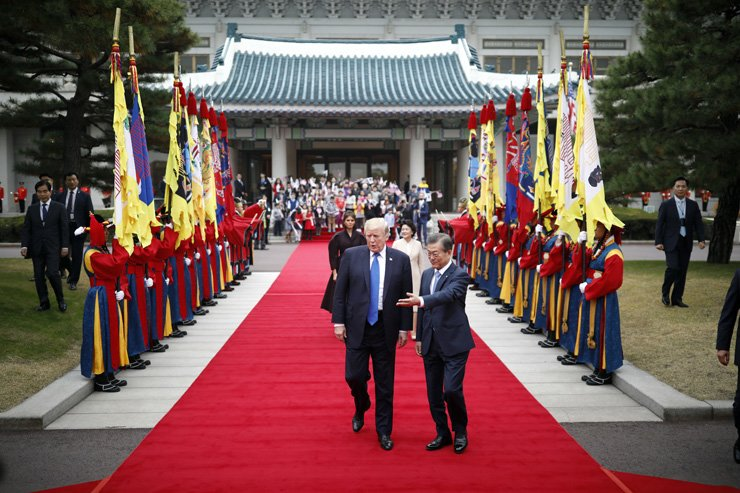 U.S. President Donald Trump, front left, walks with South Korea's President Moon Jae-in during a welcoming ceremony at the Presidential Blue House in Seoul Tuesday. / AP-Yonhap
