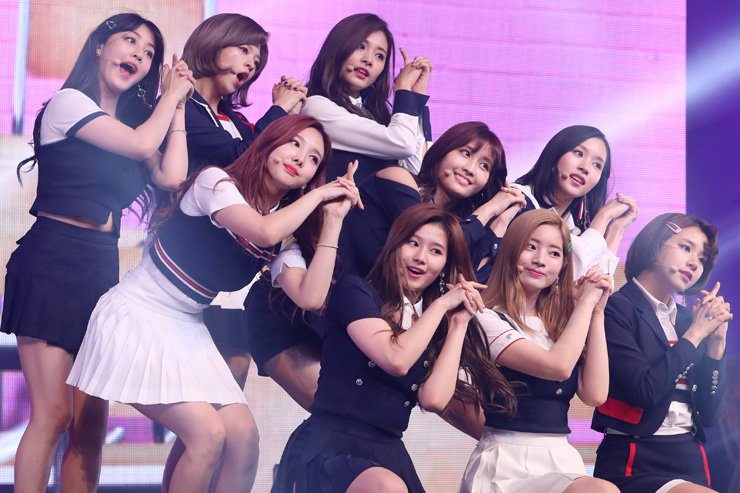 Members of K-pop girl band TWICE of JYP Entertainment perform during a press showcase for their fourth album 'SIGNAL' at Blue Square in Hannam-dong, Seoul, Monday. / Yonhap