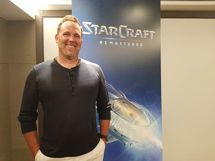 Robert Bridenbecker, Blizzard Entertainment's vice president of technology strategy and planning, poses in front of a 'StarCraft: Remastered' poster at the Aqua Palace hotel near Gwangalli Beach, Busan, July 30. / Korea Times photo by Yoon Sung-won