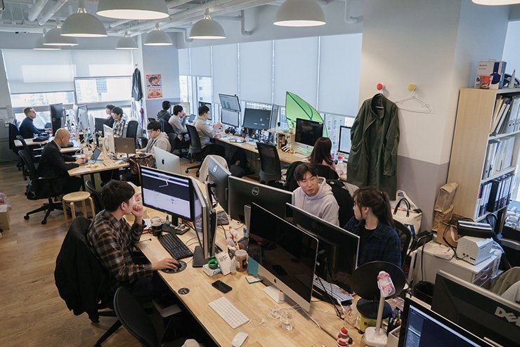 Shakr employees are seen working inside their office located in WeWork Gangnam. / Courtesy of Shakr