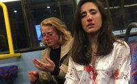 Police arrest 4 teens over homophobic attack on London bus
