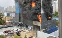 One killed in fire at building construction site