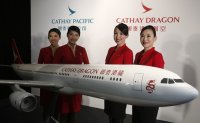 Cathay Pacific to cut thousands of jobs, close Cathay Dragon subsidiary
