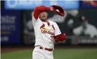 Cardinals' lefty Kim back to training from kidney illness