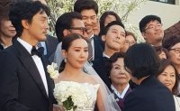 G-Dragon at sister's wedding during military service