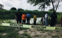 GRAPHIC IMAGE: Photos of drowned migrant and 2-year-old child stir outrage [PHOTOS]