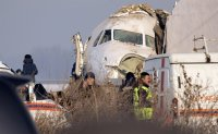 Kazakhstan flight with 98 people onboard crashes, killing at least 12