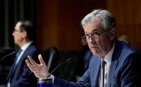Fed's Powell sees US boom ahead, with coronavirus still a risk