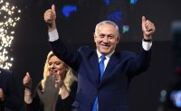 Exit polls show Netanyahu edging ahead of his main competitor in a tight race