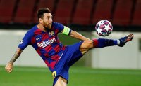 Messi unstoppable as Barca beats Napoli to reach CL last 8