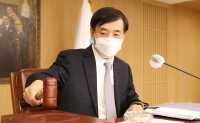Bank of Korea keeps key rate at record low as pandemic persists