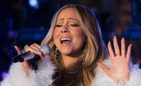 Mariah Carey is first artist to top US song chart in 4 decades