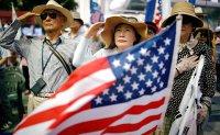 Trump fans in South Korea hail 'guardian of liberty'