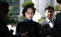 Korean Air wife arrives at Seoul's police station for questioning over alleged assaults