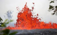 Hawaii volcano spews glowing lava