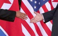 Trump, Kim kick off U.S.-North Korea summit with a handshake