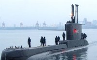 Sunken missing Indonesian submarine found cracked open by rescuers