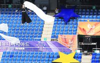 Gwangju Universiade kicks off, organizers sigh