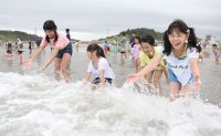 Fukushima beach opens to swimmers eight years after nuclear disaster