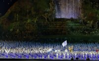 Who carries 'unification' flag at opening ceremony? [PHOTOS]