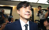 Moon's trusted aide bombarded with criticism, pressed to resign