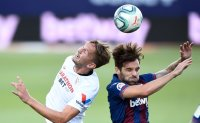 Sevilla relinquishes late lead in draw with Levante in Spain