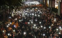 Thai protesters ask Germany to investigate their king