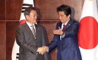 Moon, Abe voice hope for improvement in Seoul-Tokyo ties