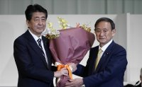 Suga wins party vote for Japan PM