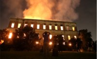 Fire fighters try to save relics as fire engulfs Rio museum