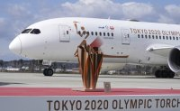 Olympic flame lands in Japan as doubts grow over Tokyo Games