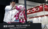 Olympics-Tokyo 2020 CEO pledges to keep Games costs under budget
