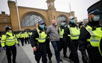 Police detain more than 150 anti-lockdown protesters in London