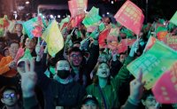 China democracy activists cheered by Taiwan election results