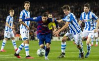 Messi's late goal puts Barcelona back on top in Spain