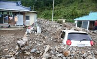 13 killed, two missing after Typhoon Mitag lashes Korea