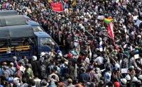 Myanmar junta imposes curfew, meeting bans as protests swell