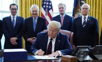 Trump signs $2,000,000,000,000 stimulus