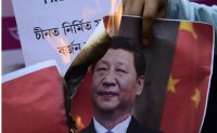 India seeks to ease tensions with China after clash