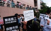 Hong Kong reports first coronavirus death