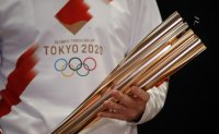Dentsu shares slide on Olympics cancellation fears