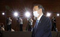 Japan's populist, pragmatic new PM Suga pushes Abe's vision