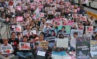 Civic groups stage rally against Japan's economic retaliation